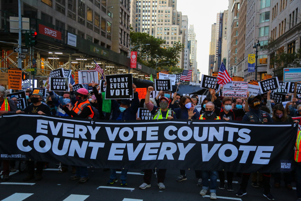 A parade with every vote counts signs
