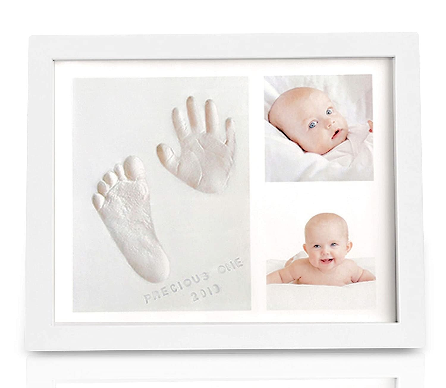 White frame with baby photos and hand and footprint