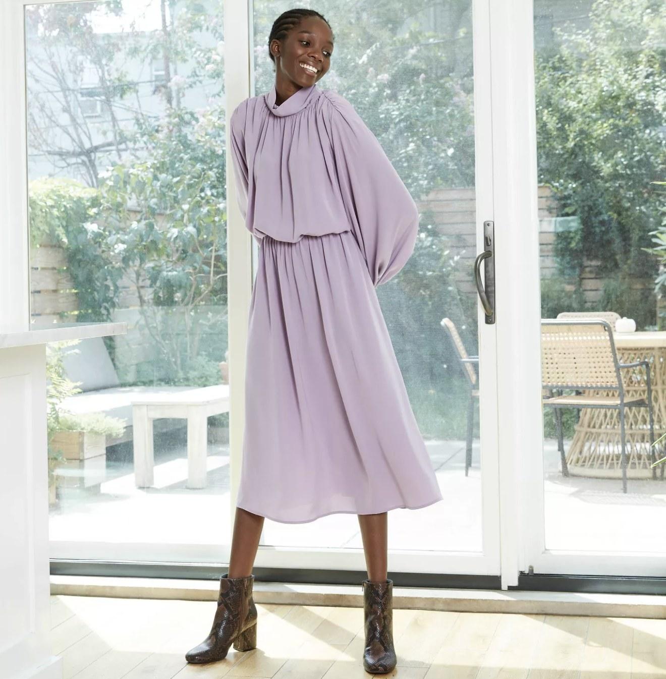 long-sleeve midi dress in purple with drapery