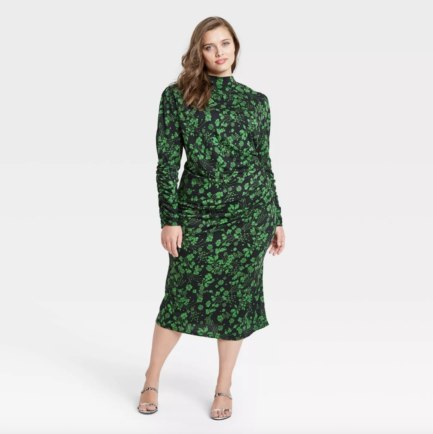 a green floral printed dress with a cinched waist