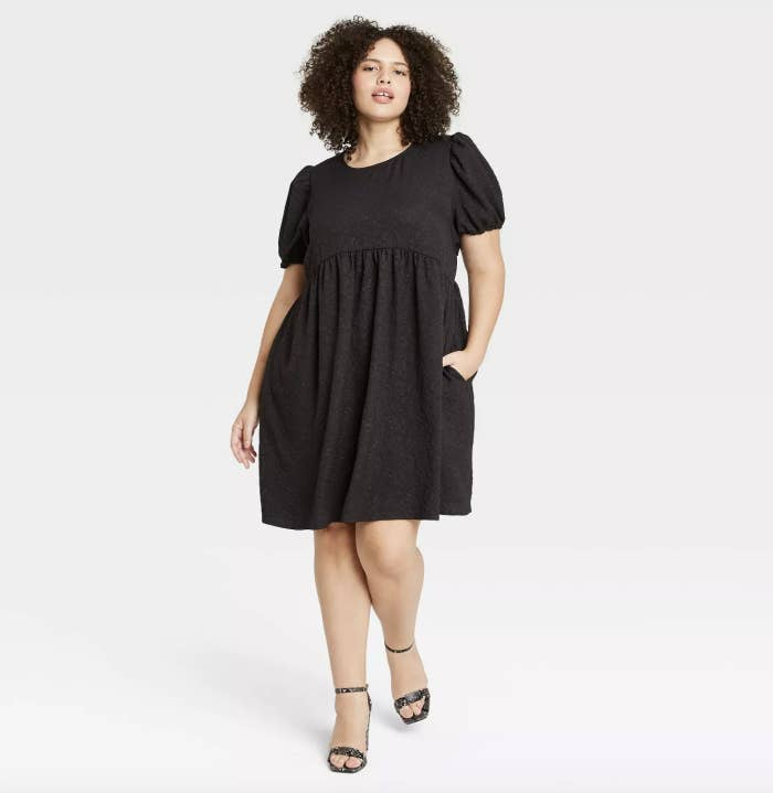 black a-line dress with puff sleeves