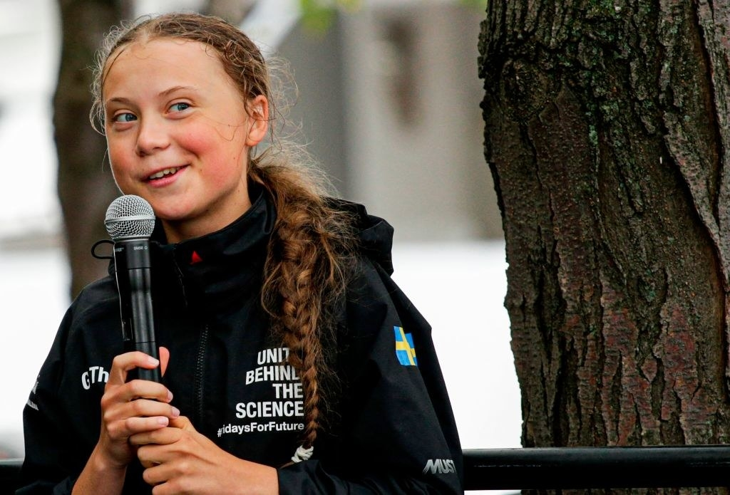 Greta Thunberg speaking into a microphone