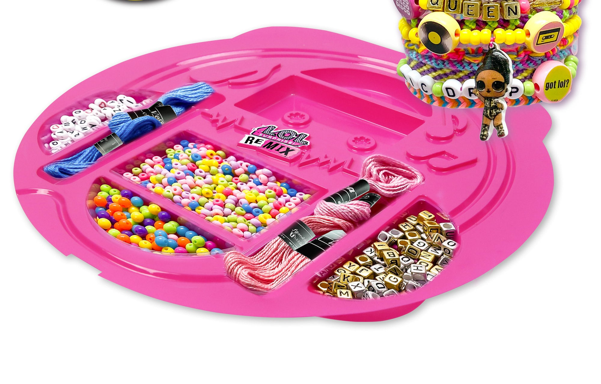 Pink tray with various beads, thread and jewelry making supplies