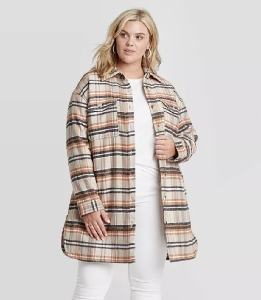 model wears plaid shirt jacket in natural colored tones