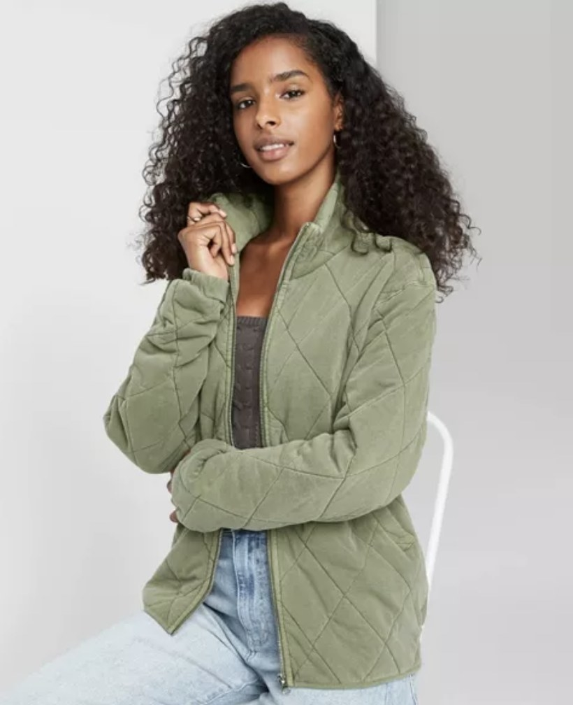 model wearing green quilted jacket