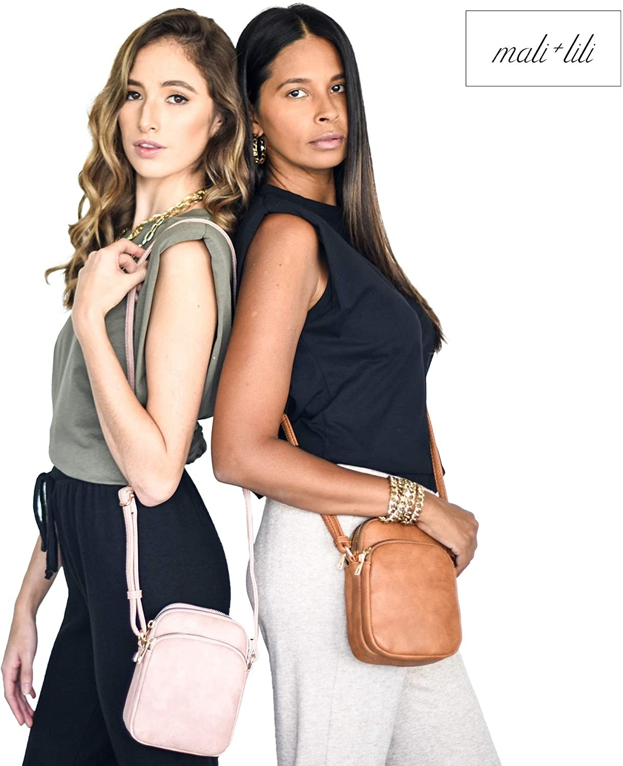 Two models, one carrying the pink bag and one carrying the camel