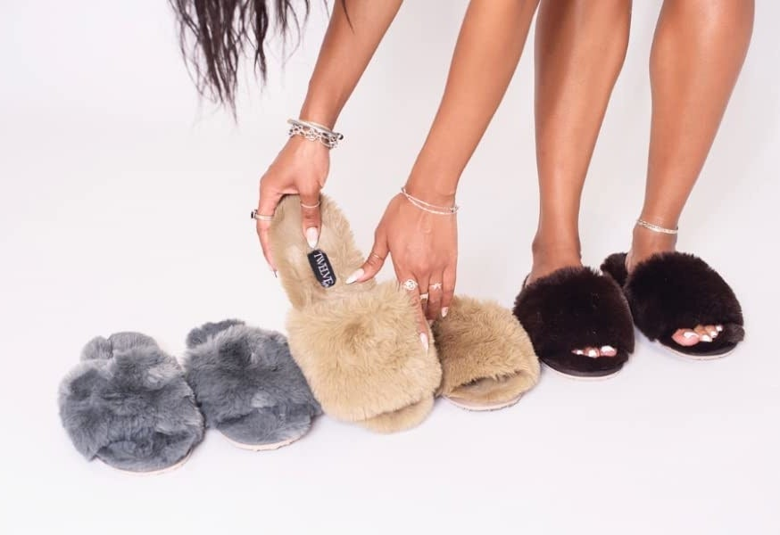 The slide slippers in grey, beige, and brown