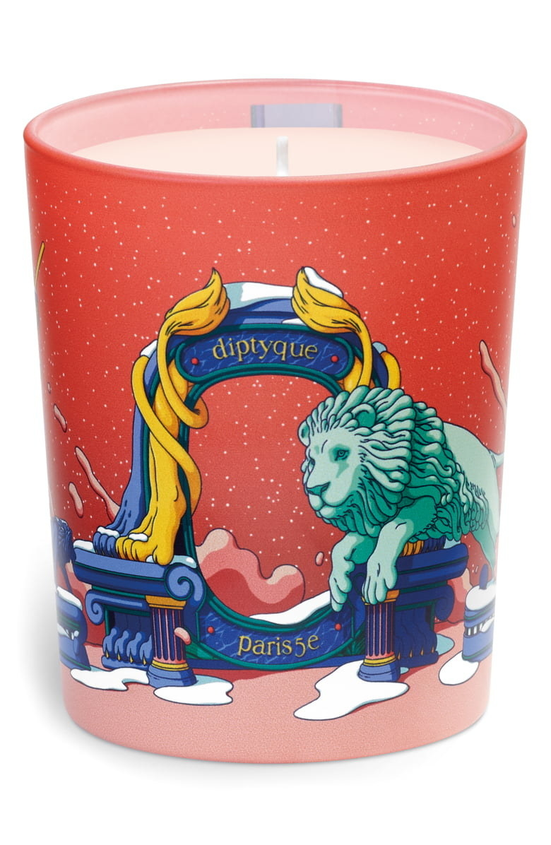 diptyque candle with red container with a lion design on it