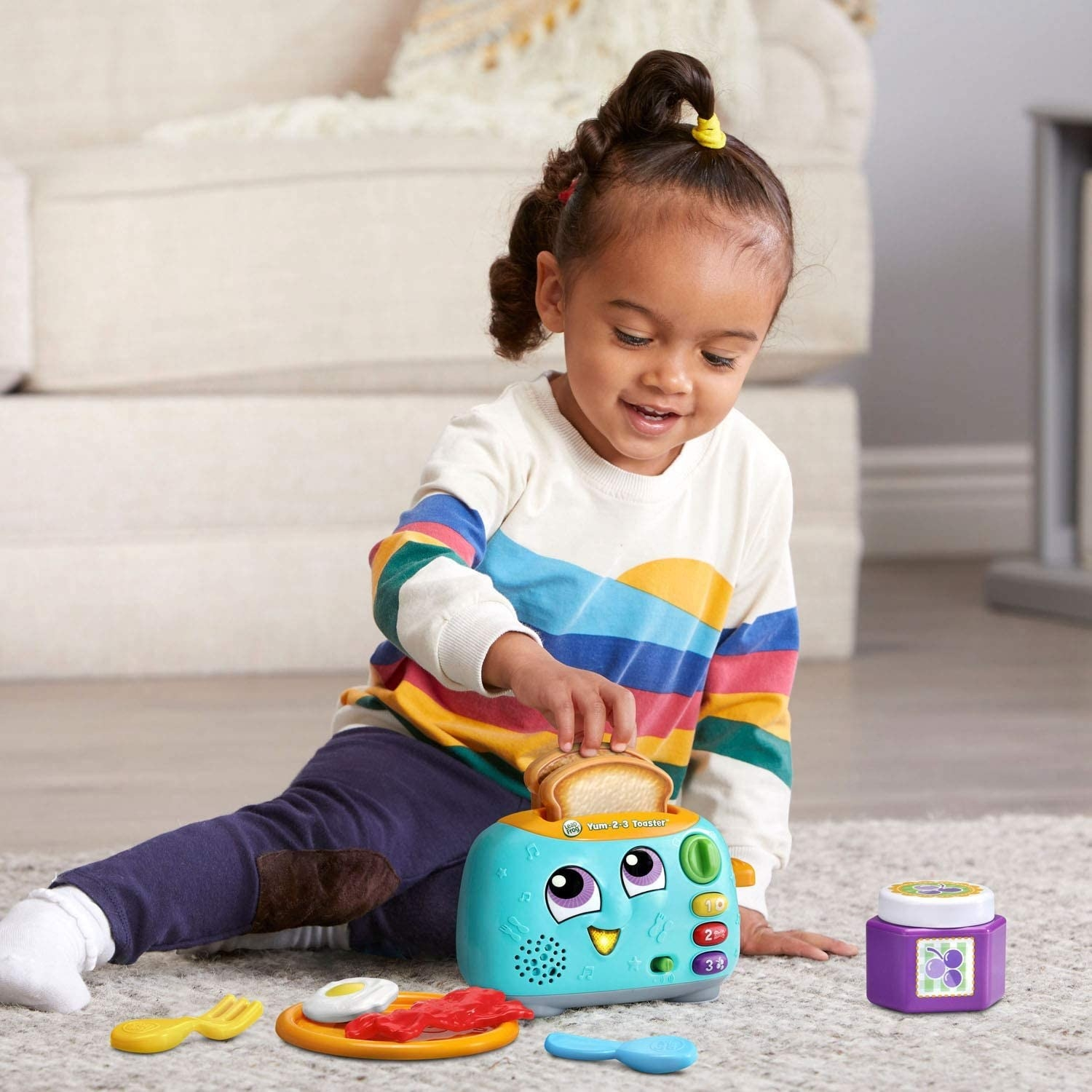 Child model playing with toaster toy
