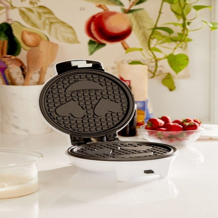happy face emoji wafflemaker sitting on a countertop