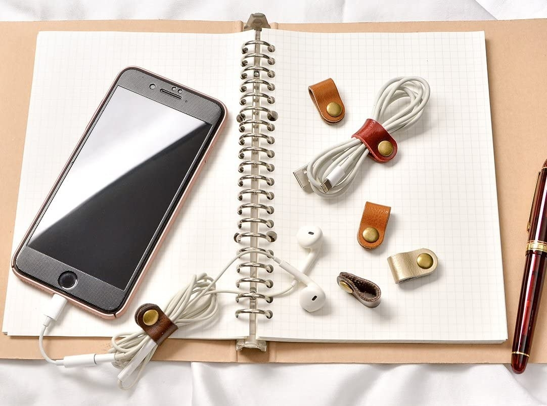 open notebook with the simple ties wrapped around ear bud cords