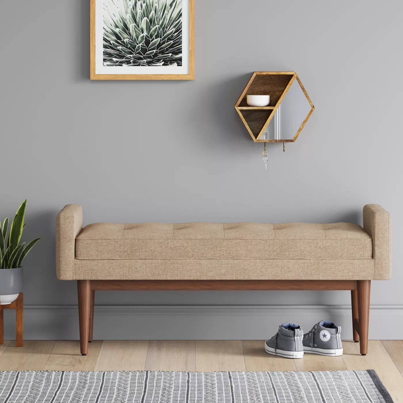 The tan-colored upholstered bench