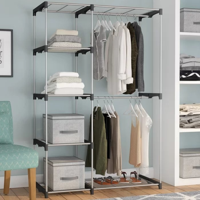 The closet system with boxes, clothes, and shoes on shelves