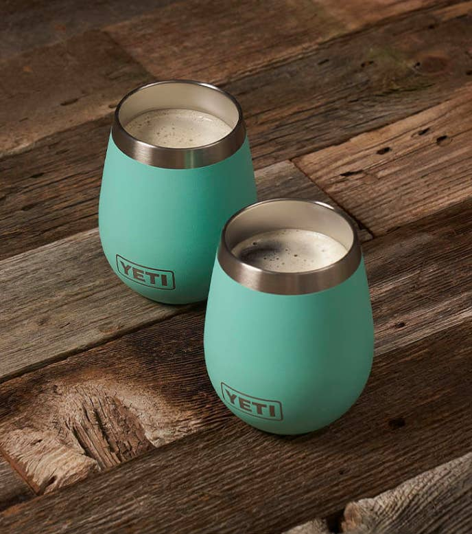 two mugs with coffee inside them