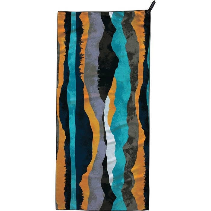 the towel in a black, orange, teal, gray and white pattern