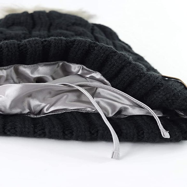 close-up of the beanie with the satin interior and adjustable drawstrings