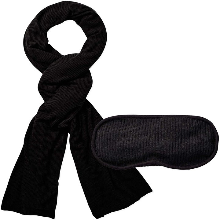 the blanket and sleep mask in black