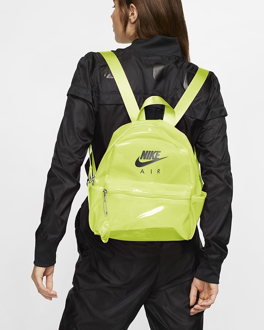 Model wearing chartreuse colored backpack