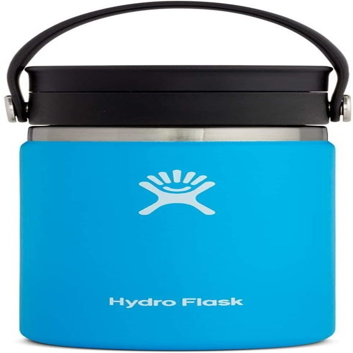 bright blue travel mug with a strap on its screw-on lid