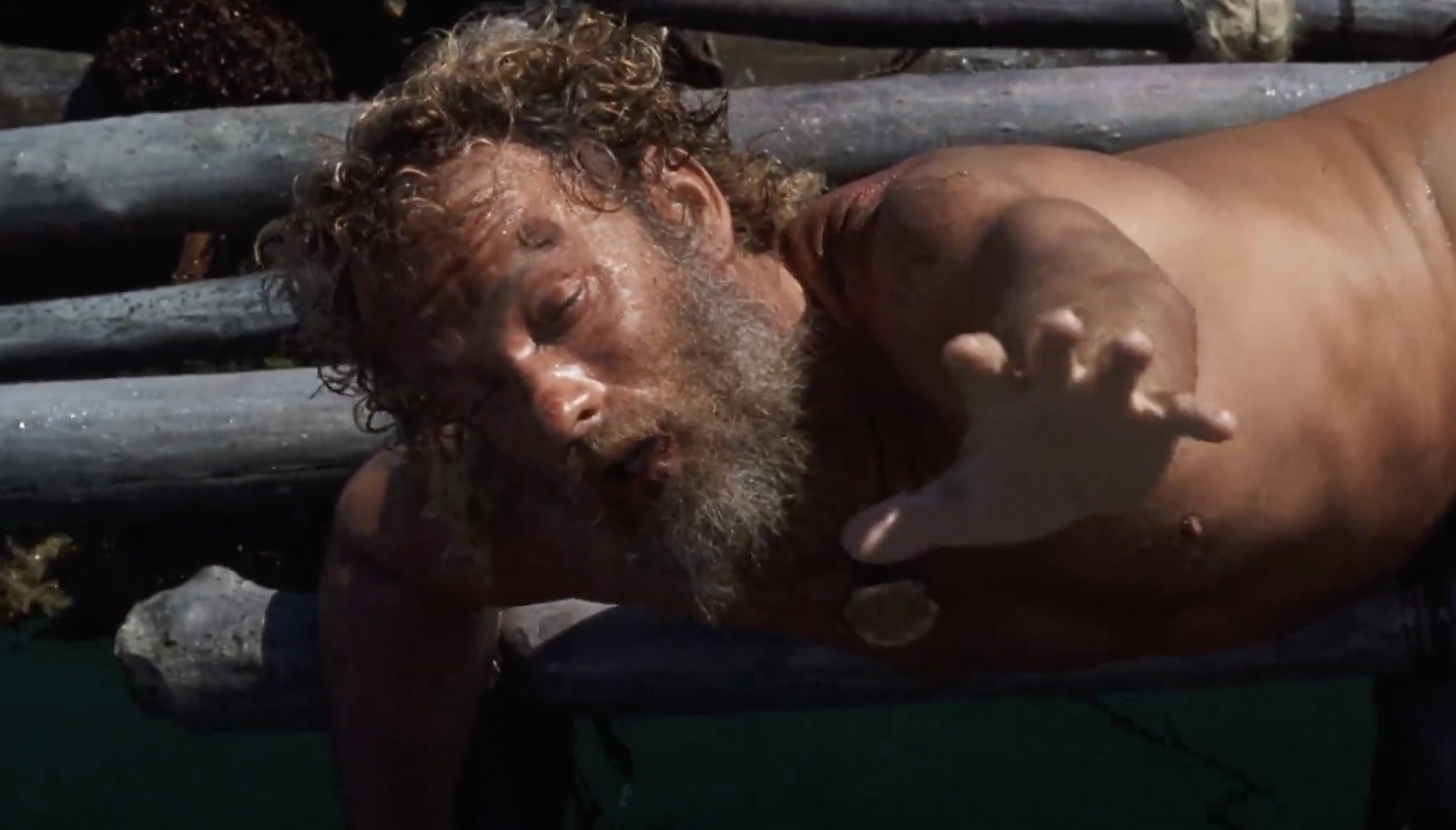 Tom Hanks as Chuck in 'Cast Away' exhausted and struggling to reach out