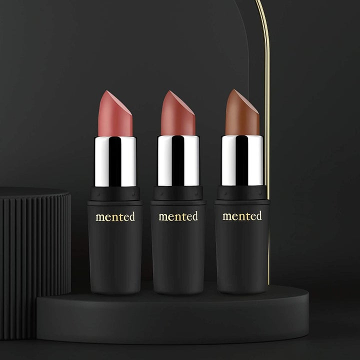 three lipsticks with the tops off showing the different shades