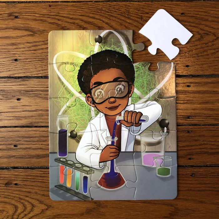 the puzzle put  together with a little boy pouring a concoction into a beaker. He's wearing a white lab coat and protective goggles. one piece is missing from the puzzle and sitting right beside it.