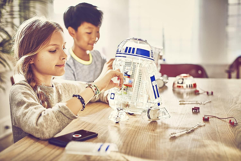 Child model building an R2-D2 droid kit