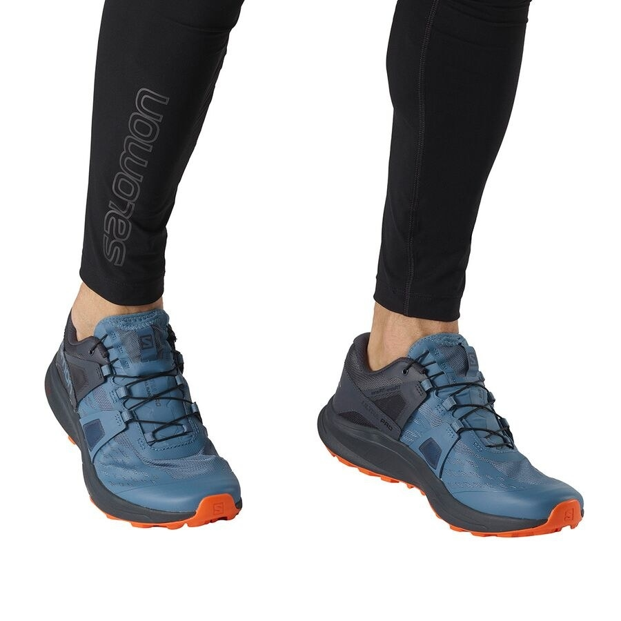 a model wearing the trail runners