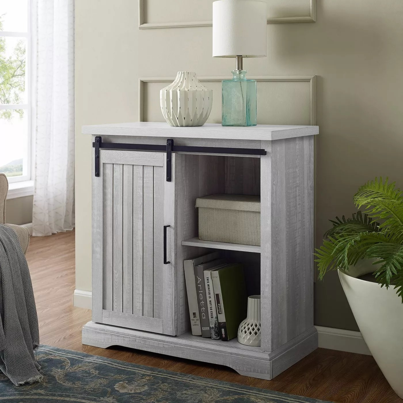 The white wooden barndoor console