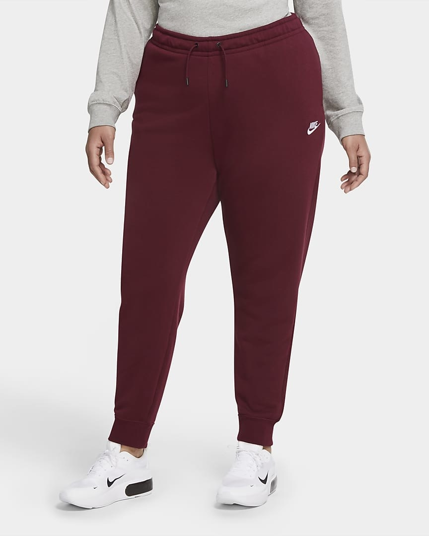 Model wearing maroon colored jogging bottoms