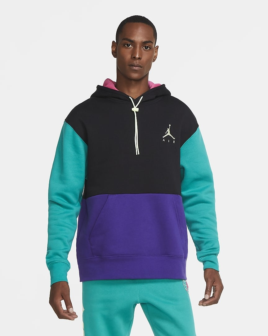 Model wearing a teal/purple/black colorblock hoodie