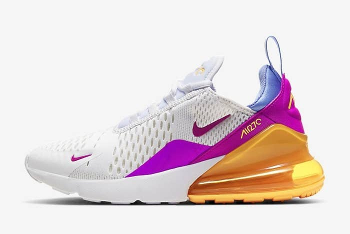 White Air Max sneakers with magenta design and Nike swoosh and orange back heel