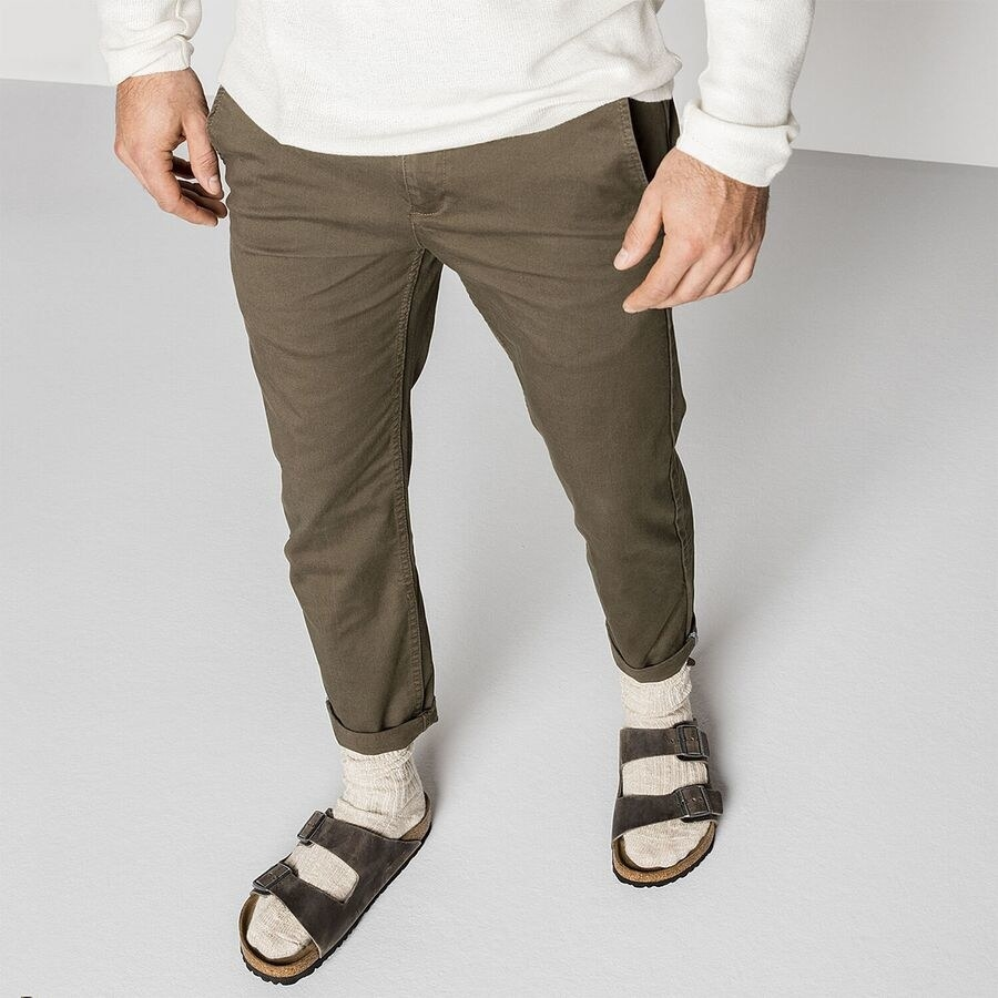 a model wearing the sandals with socks