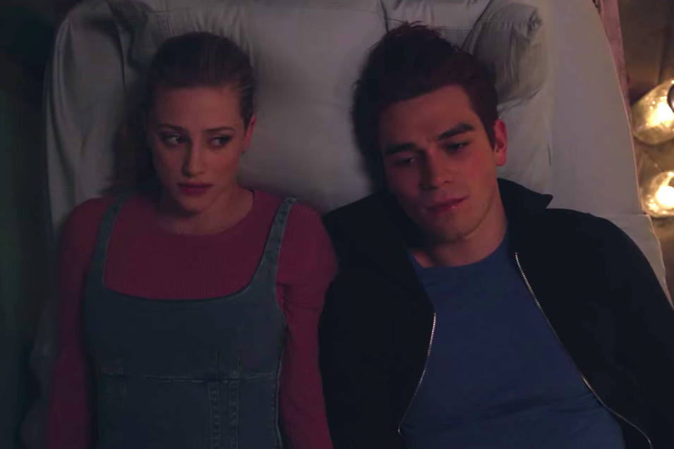 "Betty and Archie lay on the motel bed with each other looking guilty on ""Riverdale"""