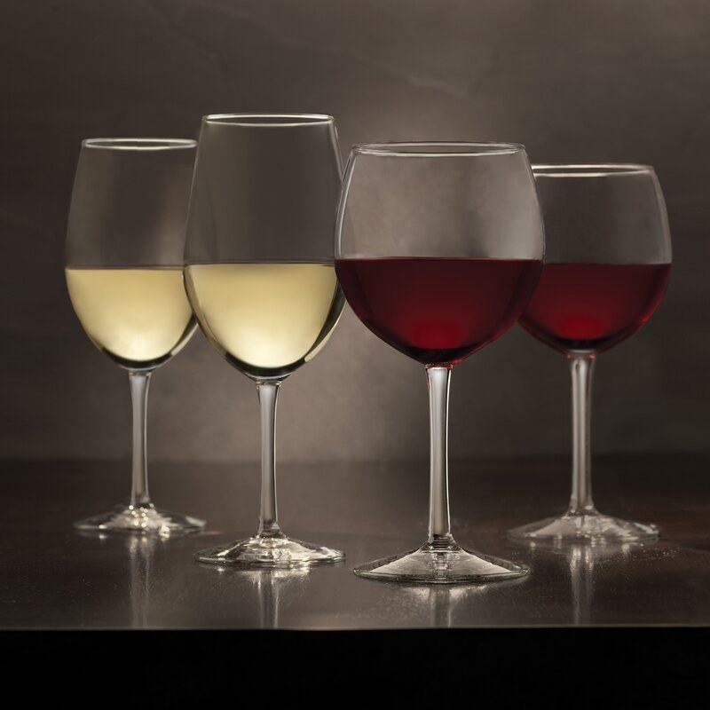 The wine glasses filled with red and white wine