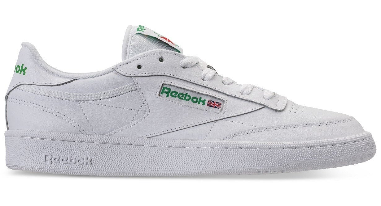 Side view of the sneakers with Reebok written in green