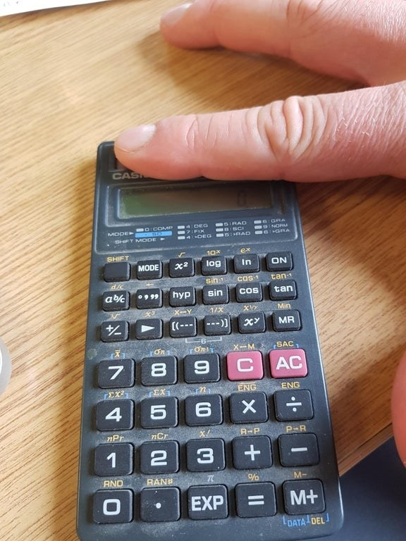 A calculator from the '90s with a solar battery panel