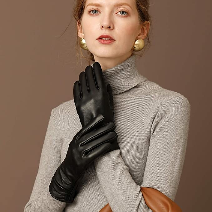 a model wears the winter leather touch screen gloves