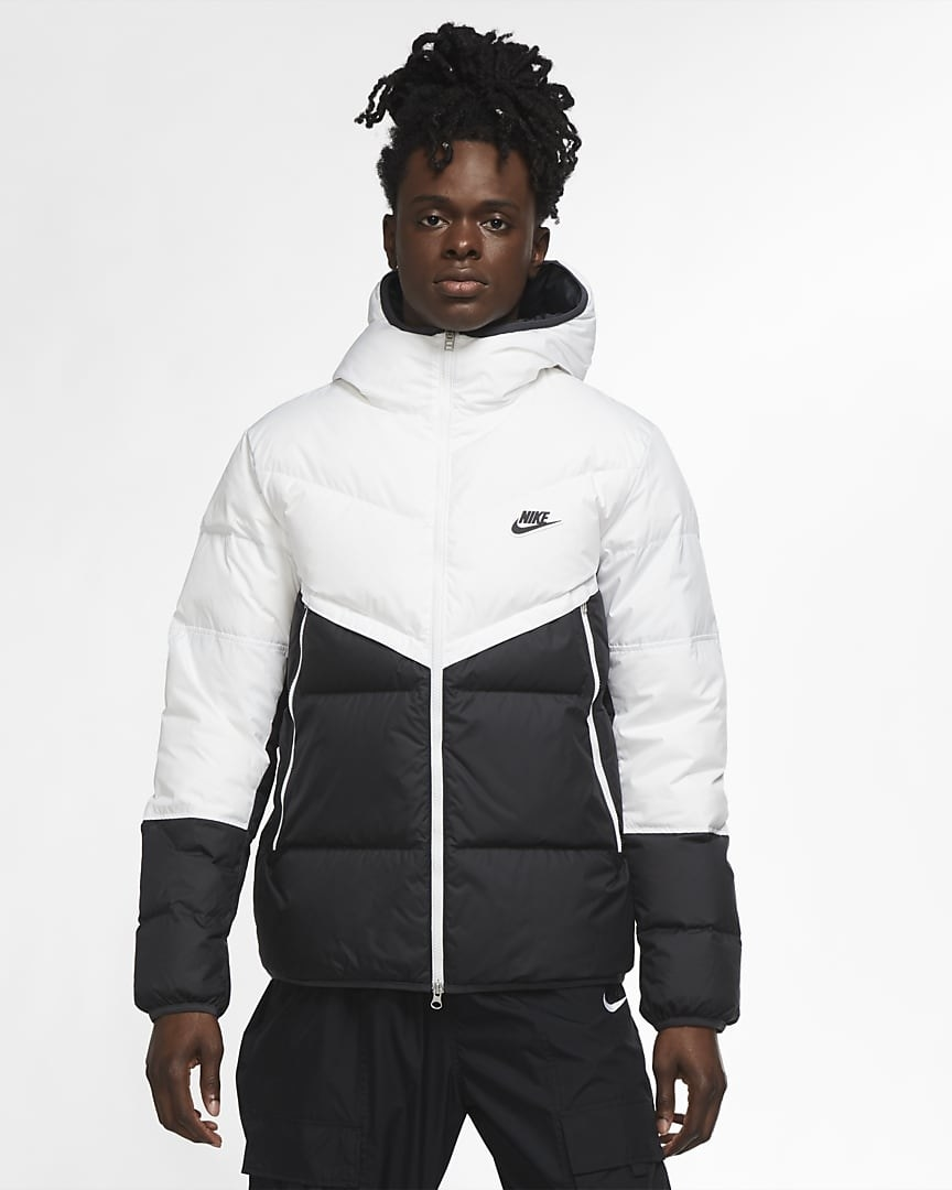 Model wearing black and white hooded down coat