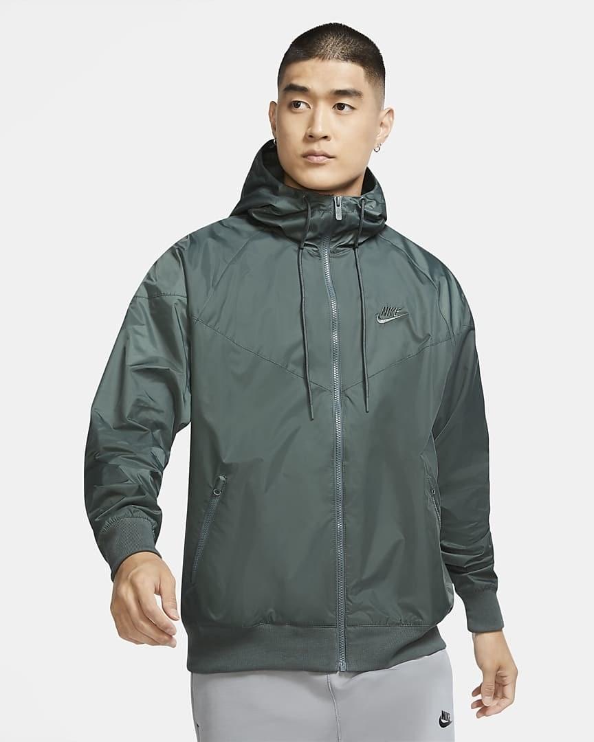 Model wearing a green/grey windbreaker