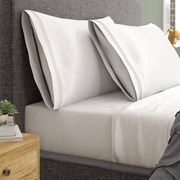 White sheets fitted on a bed to show their quality and color