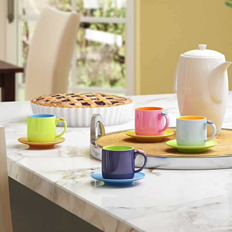 The espresso set with matching saucers in mismatched bright colors