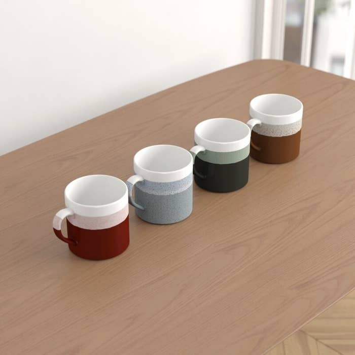 The four mugs with different modern-style layers of colors