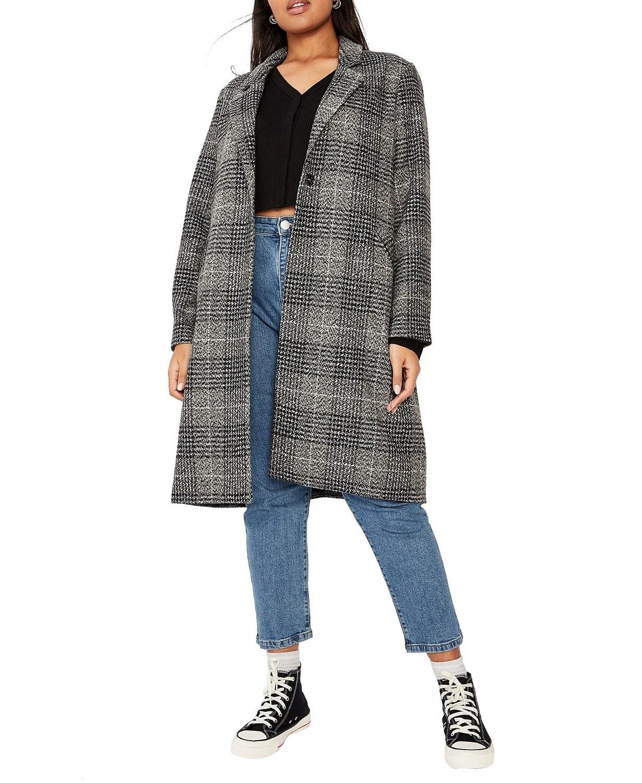 A model wearing the coat