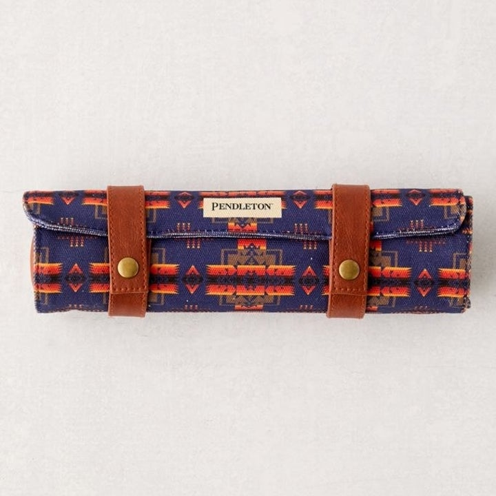 Pendleton chess and checkers set rolled up in its carrying case