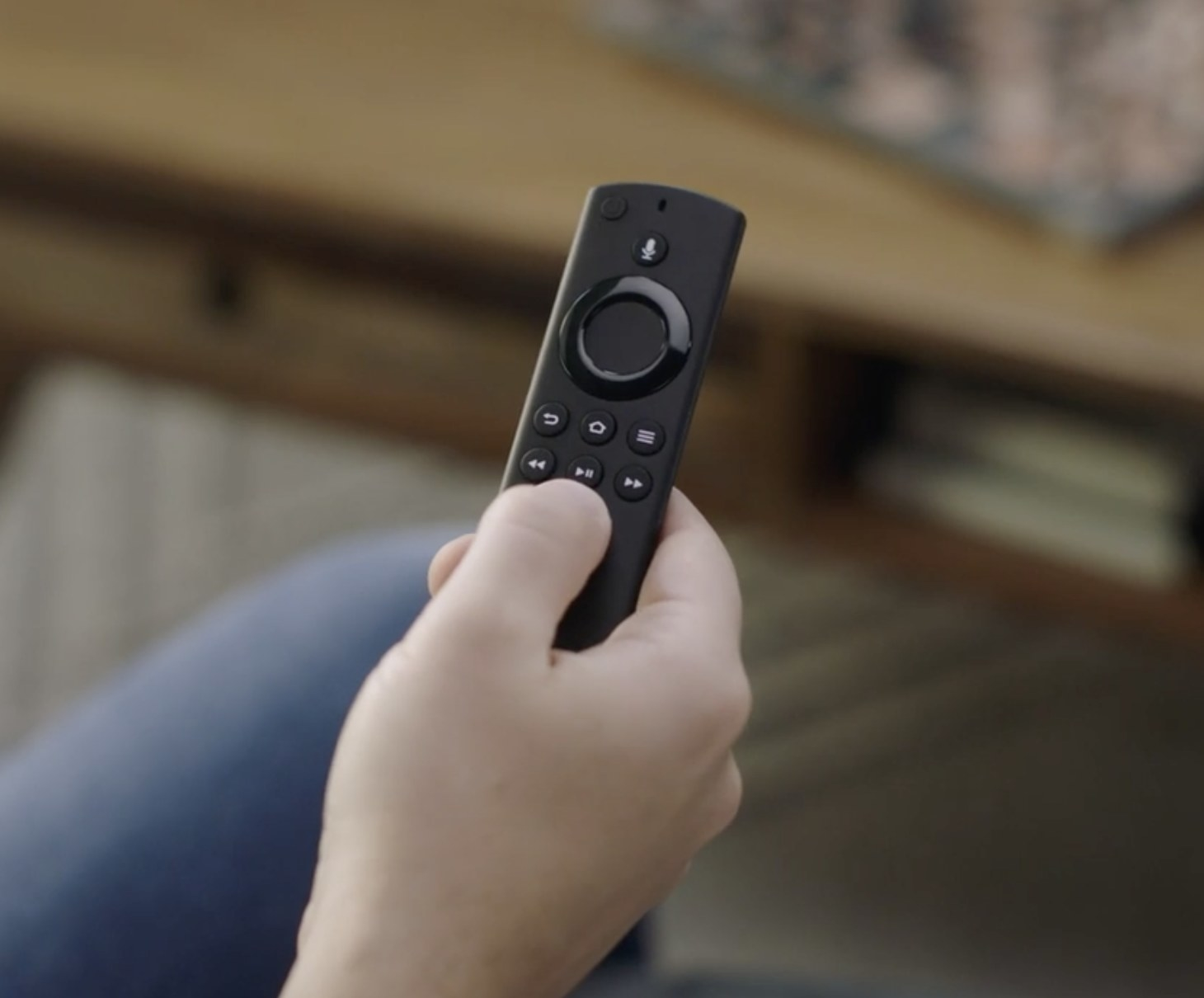 Person is holding the Amazon Fire stick