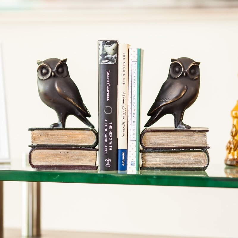 The bookends holding up three books