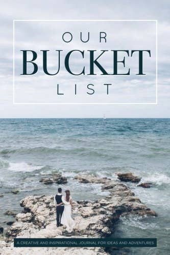 The cover of the bucket list book with a couple standing on rocks overlooking an ocean