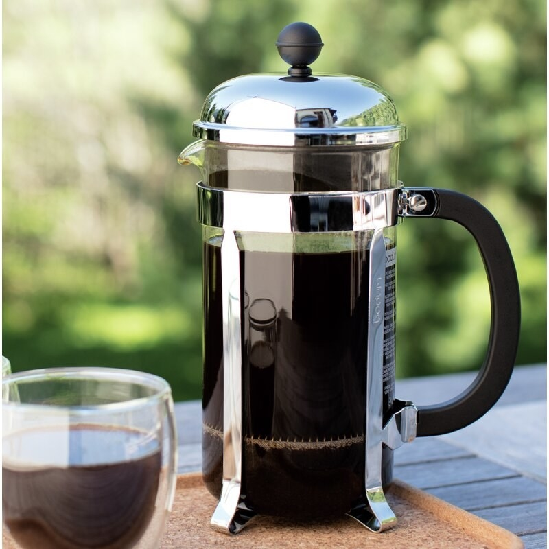 The French press brewing coffee to show its size