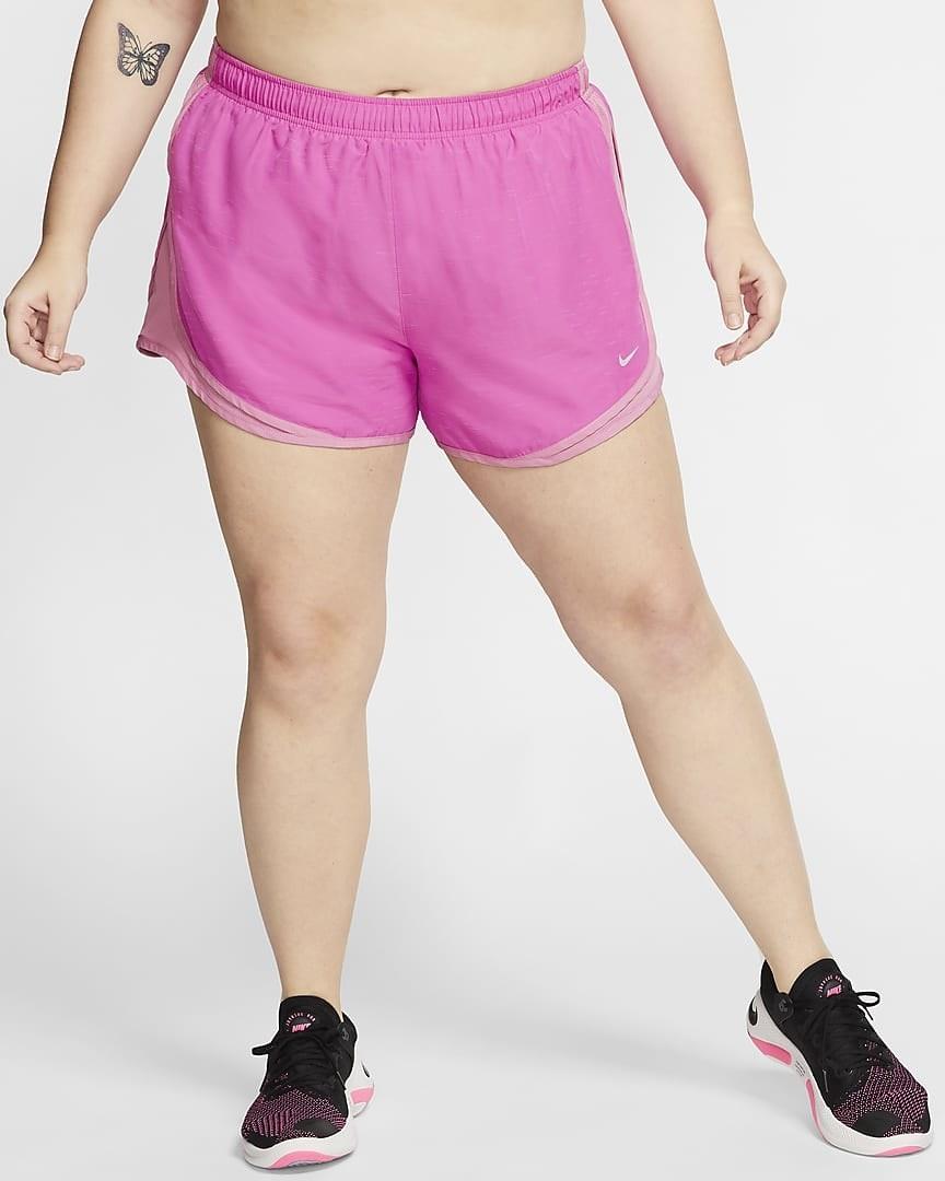 Model wearing pink workout shorts
